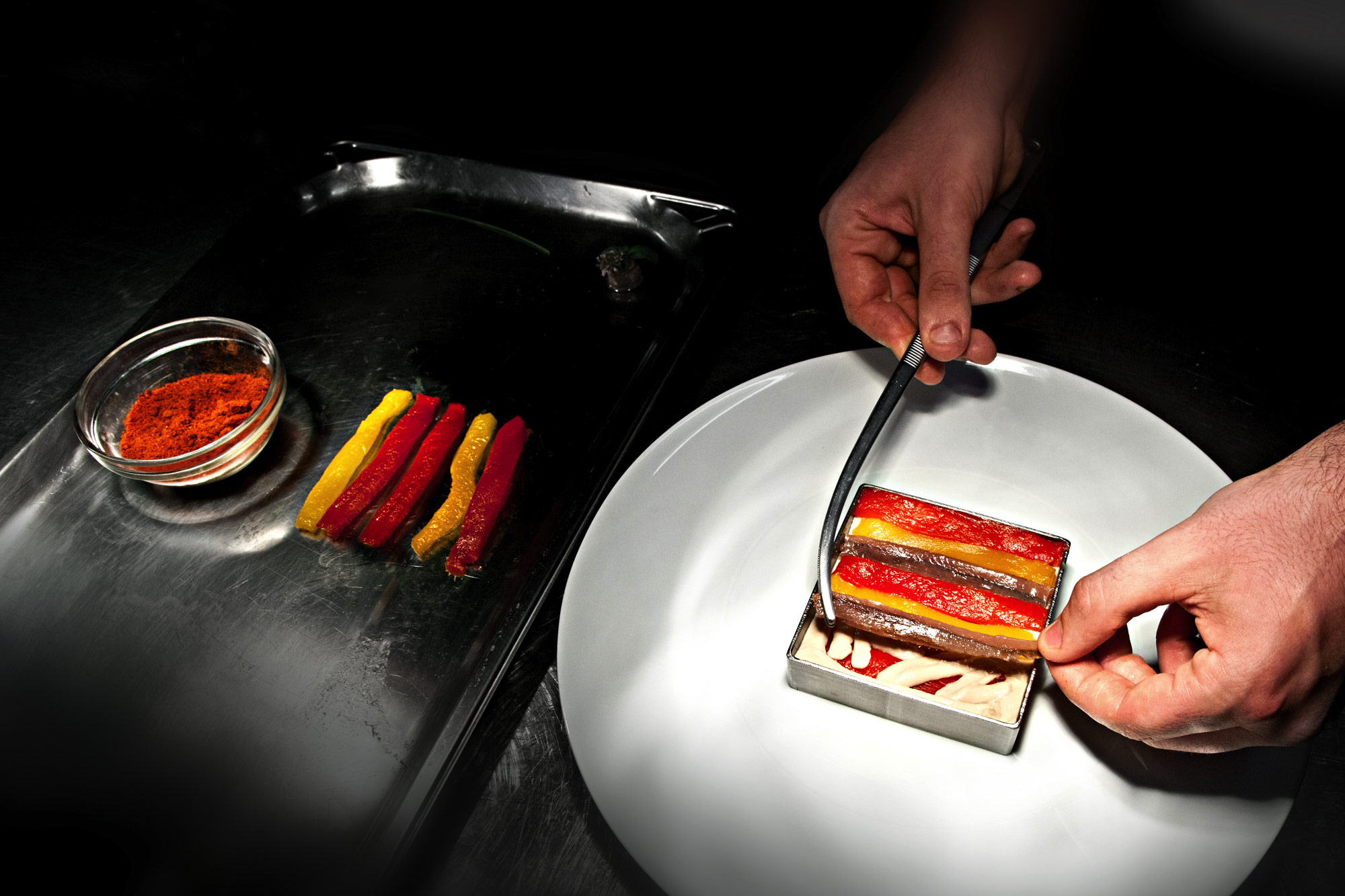 Millefeuille of squared peppers, Cantabrian sea anchovies and roasted eggplant.