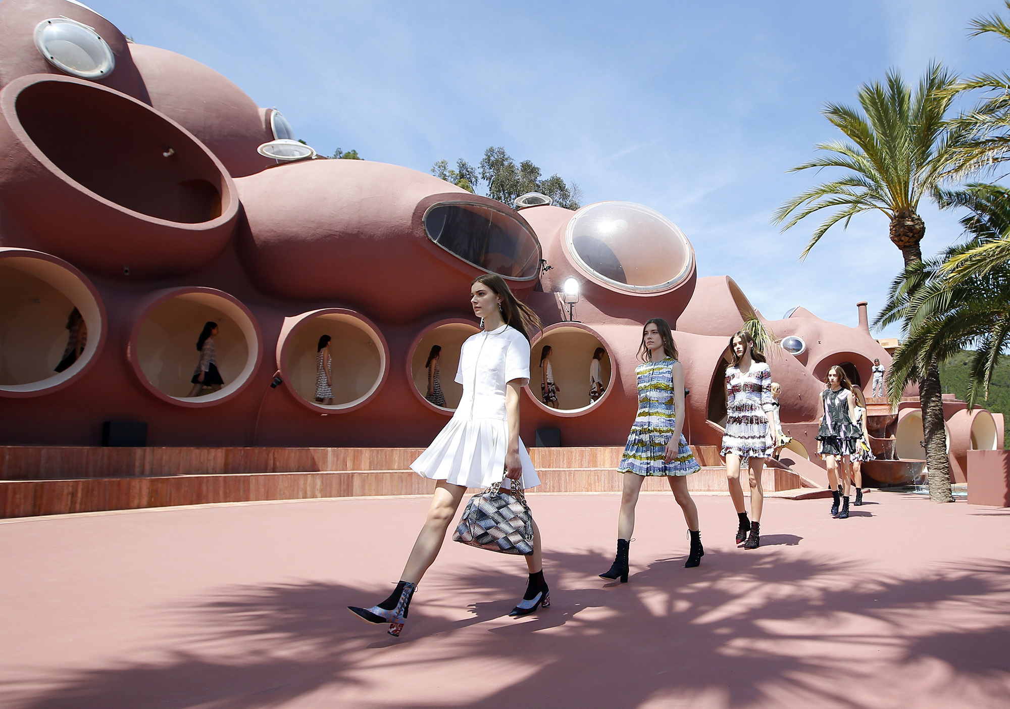 Models present creations by Belgian fashion designer Raf Simons during the Dior 2016 cruise collection show, on May 11, 2015 at the Palais Bulle (Photo credit should read VALERY HACHE/AFP/Getty Images)